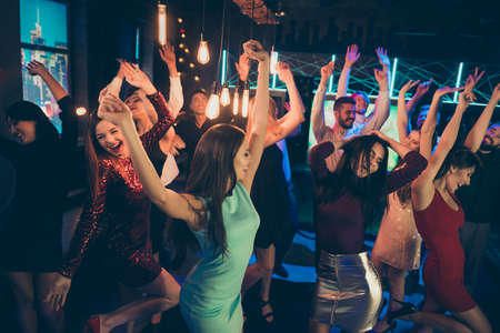 Lets party hard. Portrait of cheerful positive people and bachelorette want have perfect event after studying go nightclub enjoy music dance scream feel rejoice Фото со стока