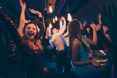 Portrait of cheerful positive people have fun on party celebrating mates anniversary birthday wear formalwear outfit go in nightclub dance feel rejoice crazy discotheque Фото со стока