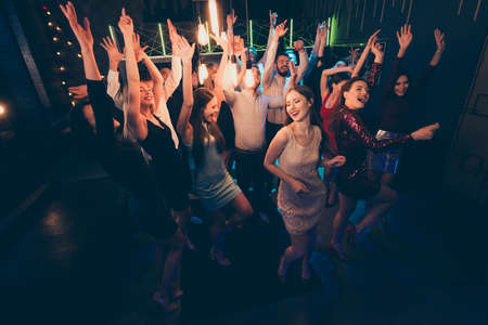 Top above high angle photo of crazy cheerful students corporate company want celebrate mate birthday visit nightclub enjoy music dance scream have fun party wear formalwear dress