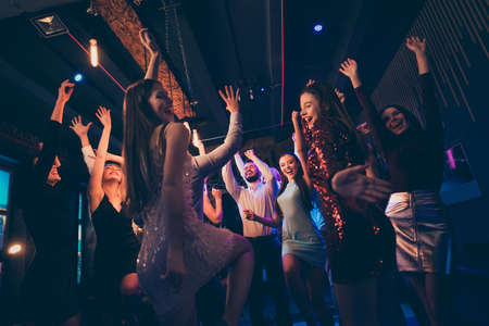Portrait of cheerful positive youth people have fun on discotheque dance feel crazy on festive events wearing formalwear dress outfit Фото со стока