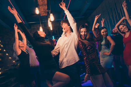 Portrait of positive cheerful couple visit event party dance feel wild crazy rejoice enjoy weekends nightlife event have fun wear formalwear outfit dress in discotheque