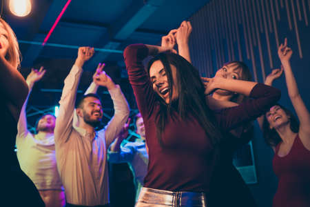 Close up photo of delighted girl youth have fun on party celebrating her mates birthday anniversary dance feel rejoice content scream wear formalwear clothing visiting modern nightclub