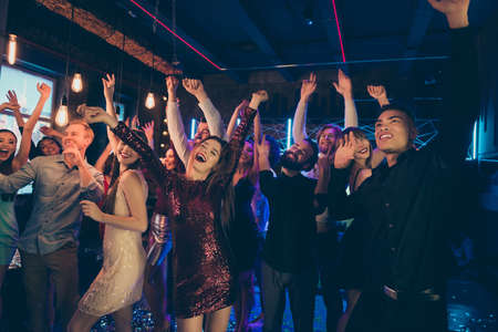 Portrait of positive cheerful group of buddies want have perfect weekends dance floor feel rejoice crazy wear formalwear dress skirt in discotheque