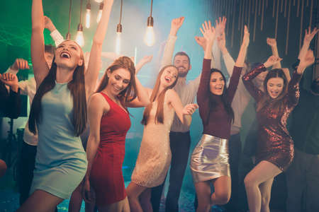 Portrait of positive cheerful buddies couple want have perfect fun holidays go dance club party hard feel rejoice on discotheque wearing formalwear dress skirt