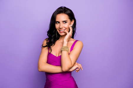 Close-up portrait of her she nice-looking attractive glamorous stunning charming cheerful foxy curious sly cunning wavy-haired lady biting nail isolated over violet purple lilac pastel background