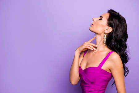 Close-up profile side view portrait of her she nice-looking attractive glamorous luxurious stunning adorable dreamy wavy-haired lady touching neck isolated over violet purple lilac pastel background
