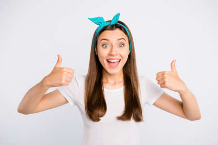 Portrait of cheerful funky enthusiastic girl promoter show thumb up pick tips recommend discounts give feedback say its alright wear stylish clothes isolated over white color background