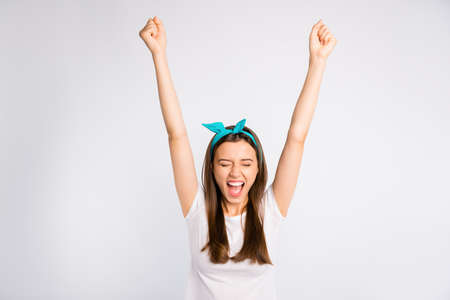 Portrait of crazy ecstatic girl feel euphoria emotions raise fists scream yeah celebrate victory wear casual style outfit isolated over white color background