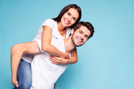 Portrait of his he her she nice attractive lovely charming cute sweet tender cheerful cheery soulmate piggybacking having fun isolated on bright vivid shine vibrant blue turquoise background Stok Fotoğraf