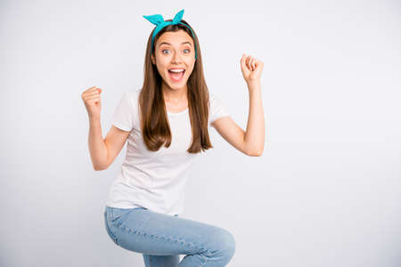 Omg i winner. Portrait of astonished expression girl hear wonderful news scream wow unbelievable raise fists celebrate victory in competition wear casual style clothes isolated white color background Stok Fotoğraf