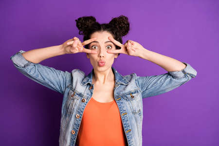 Portrait of funny funky girl have 14-february holiday date greet her boyfriend feel fun make v-signs near face send air kisses wear good-looking clothes isolated over violet color background