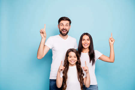 Portrait of surprised funky three people promoters scream wow omg point select discounts decide decisions choose choice wear white t-shirt isolated over blue color background