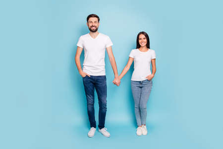 Full length photo of candid spouses married sweethearts have weekend holiday date wear good look outfit sneakers isolated over blue color background