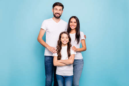 Portrait of cheerful idyllic three brunette hair people big family feel confident cool hug have fun wear white t-shirt denim jeans isolated over blue background Stock fotó