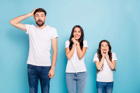 Portrait of impressed three brown hair people hear information scream wear white t-shirt denim jeans good look isolated over blue color background