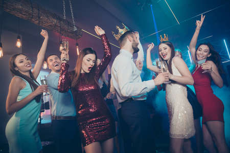 Clink cheers toast for excited prince and princess. Photo of excited cheerful glad carefree buddies celebrating prom with winners drinking alcohol beverages Stockfoto