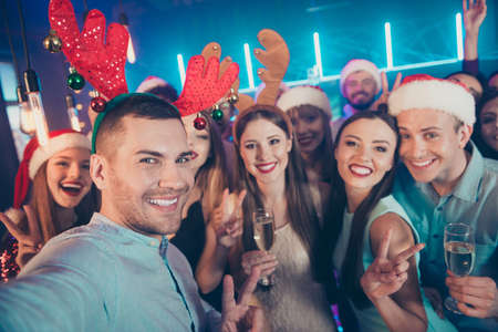 Close up photo portrait of positive carefree having good time at eve x-mas taking selfie  in santa claus hat raising glass sating toast for upcoming year 2020 Stock Photo