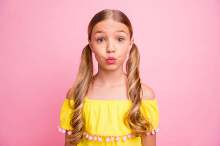 Photo of beautiful little lady sending air kisses to classmate boy flirty mood wear bright shiny off-shoulders yellow blouse isolated pink color background