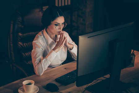 Portrait of her she nice attractive lovely stylish intelligent lady auditor top executive manager solving difficult task deadline creating launch IT startup at night dark work place station indoors