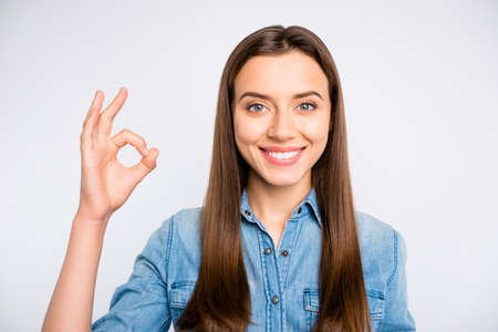 Close up photo of confident cool promoter girl show ok sign pick tips wear casual style clothes isolated over white color background Imagens