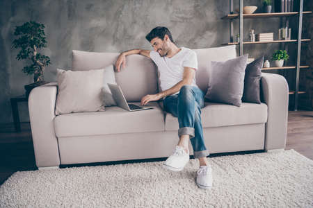 I miss you so much. Profile photo of mixed race guy sitting cozy sofa holding notebook speaking skype with relatives communicating wear casual outfit flat loft living room indoors