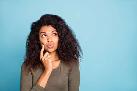 Portrait of thoughtful pensive black skin girl think try choose decide right choice decision solution make lips pouted plump wear style jumper isolated over blue color background