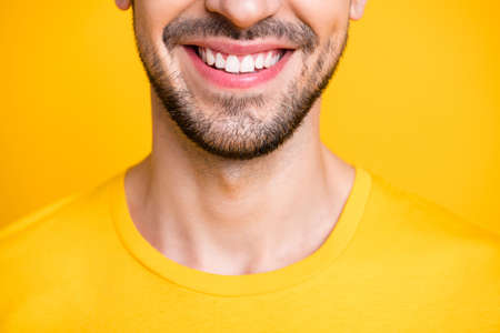 Closeup cropped photo of amazing macho guy looking mirror examining teeth after dental laser cleaning wear casual t-shirt isolated yellow color background Zdjęcie Seryjne