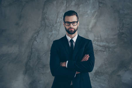 Portrait of serious concentrated guy worker work in big large enterprize cross hands ready decide decision choose choice wear stylish suit black job clothes isolated over grey color background