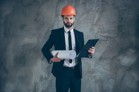 Portrait of serious confident man worker architect hold blueprint clipboard want organize builders job wear black trendy tux tuxedo isolated over grey color background