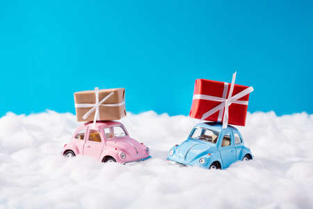 Photo of two small boy and girl cars, driving present giftboxes loaded on roof xmas tradition romantic surprise greeting each other best dream colorful north-pole concept