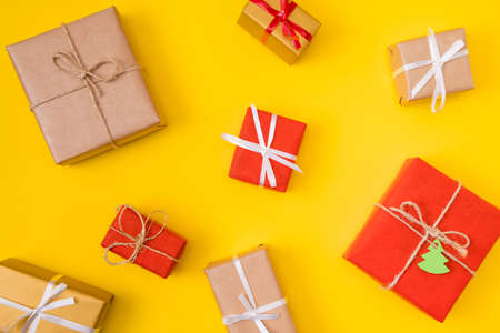 Top above high angle photo of christmas tradition new year celebration, gift boxes flatlay overhead isolated over red yellow color background Stock Photo