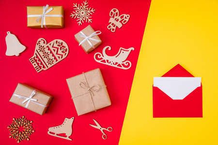 Top above high angle view photo of giftbox wooden gloves ice skates, bells sledges snow flakes santa claus letter creative composition flatlay isolated bright shine color background