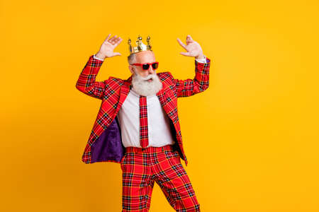Portrait of his he nice handsome attractive rich wealthy funky gray-haired man dancing, having fun amusement chill out isolated over bright vivid shine vibrant yellow color background