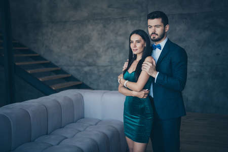Photo of two worried stylish trendy people fiance guy and bride lady standing piggyback position romance mood waiting wedding day wear classy formalwear suit short mini dress loft indoors