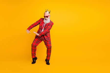 Full body photo of funny grandpa white beard dancing strange youngster moves little drunk wear crown sun specs gingham red costume isolated yellow color background