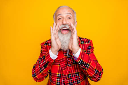 Photo of cool modern look grandpa with white beard yelling announcement loudly holding hands near mouth wear plaid red blazer tie clothes isolated yellow color background