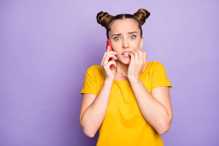 Photo of pretty lady holding telephone speaking school teacher listening scolding about skipping classes wear yellow t-shirt isolated on pastel purple background
