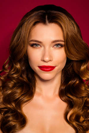Vertical close-up portrait of her she nice attractive charming confident wavy-haired girl glamorous life isolated bright vivid shine vibrant red maroon burgundy marsala color background Stock fotó