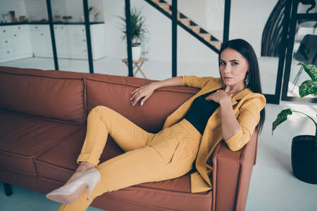 Portrait of her she nice-looking fashionable attractive charming stunning perfect lady lying posing on sofa new home rent in modern style interior glass room flat house home Reklamní fotografie