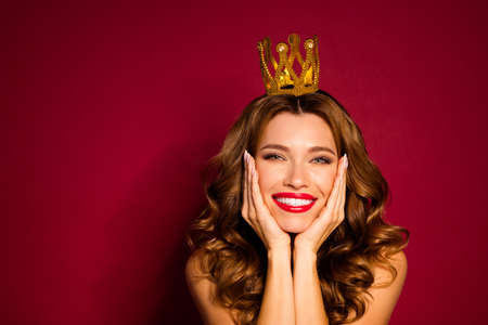 Photo of model lady red pomade shoulders golden crown on head arms cheekbones enjoy celebrity social status isolated burgundy color background