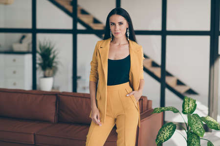 Portrait of her she nice-looking attractive glamorous lovely content lady model new owner project designer in modern style interior glass open space room flat house indoors