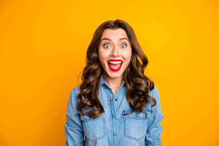 Photo of cheerful cute charming fascinating girl screaming expressing emotions with face with her lips pomaded red isolated over vivid color background