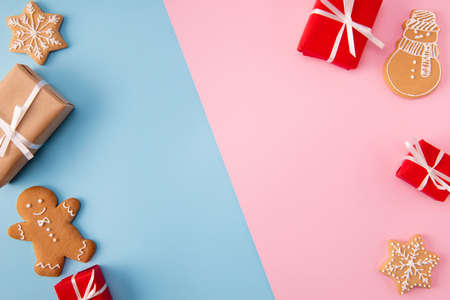 High angle view photo of shared divided into two parts background pink and blue colors decorated with creative holiday bakery figures giftboxes x-mas postcard concept idea