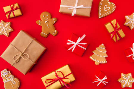 High angle above view photo of surprise holiday newyear biscuits cookies gifts congrats decor figures sweet x-mas brochure composition isolated bright red background Imagens