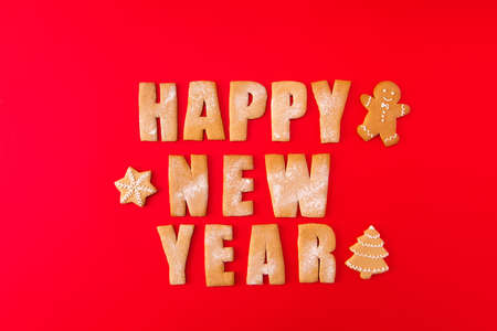 High angle view photo of three baked newyear congrats words with decorative elements figures sweet yummy x-mas composition isolated on bright red background