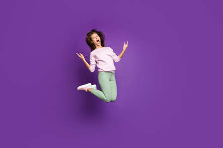 Full length body size view of her she nice attractive lovely comic childish overjoyed cheery girl jumping showing horns sign isolated on bright vivid shine vibrant purple violet lilac color background
