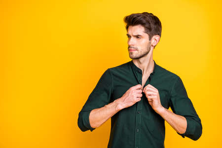 Profile side photo of serious stunning rich wealthy guy millionaire adjust button on his shirt look attract girls on summer weekends wear modern outfit isolated over yellow color background