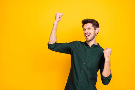 Photo of cheerful positive nice attractive millennial rejoicing in winning lottery smiling toothily shouting with happiness isolated vibrant color background