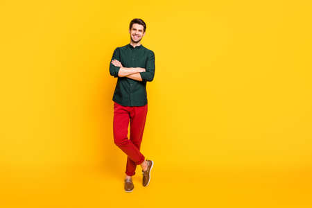Full size photo of charming attractive imposing guy feel he real professional entrepreneur rich wealth millionaire feel satisfied wear modern youth clothing sneakers isolated yellow color background Фото со стока