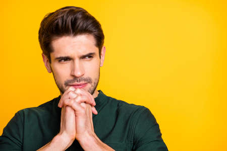 Close up photo of thoughtful guy have difficult question he need solve think ponder feel unaware emotions wear casual style outfit isolated over yellow color background Stock fotó